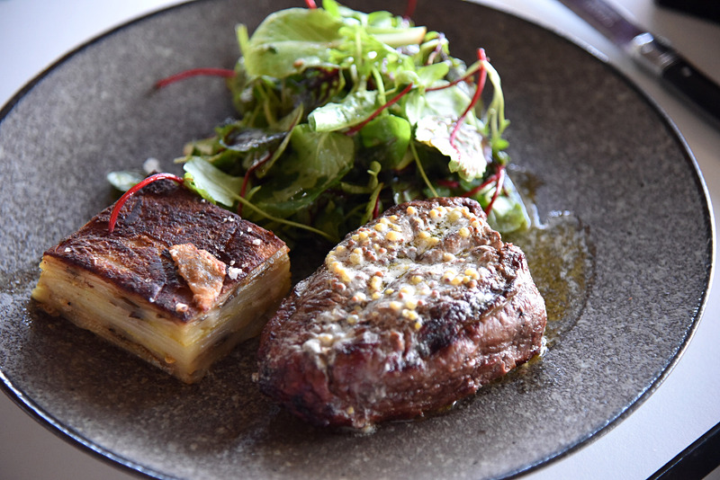 「AACO Darling Downs Wagyu7 + scotch fillet 300g, potato and eggplant gratin, French mustard butter」